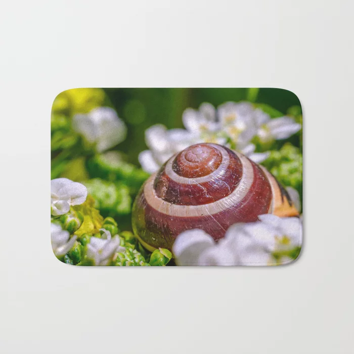 Abandoned Snail Shell. Macro Photograph Bath Mat by lovefi